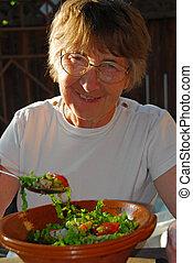 glücklich, essende, ältere frau
