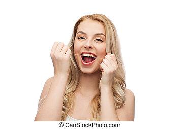 glücklich, junge frau, mit, zahnseide, reinigende zähne