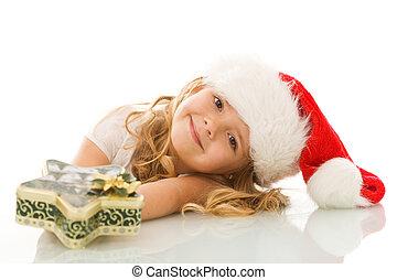 glücklich, kleines mädchen, mit, nikolausmuetze, und, weihnachtsgeschenk