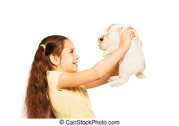 glücklich, kleines mädchen, spiel, klein, weißes kaninchen