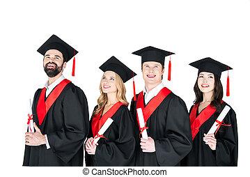 glücklich, studenten, in, gradierungskleider, und, mörtelbretter, besitz, diplome, weiß