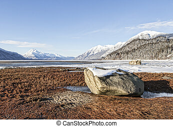 Large rocks left behind by glaciers in the Chilkat estuary near Haines Alaska in winter.