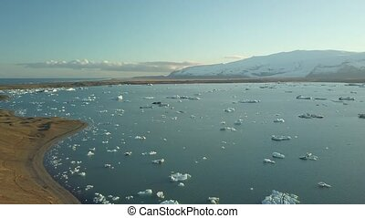 Glacial lake in Iceland - Glacial lake in Jokulsarlon,...