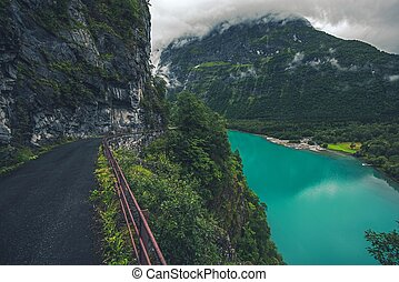 Glacial Lake in Norway. Mountain Winding Cliff Road and the...