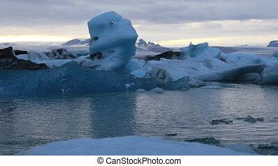 Glacial lake Jokulsarlon at dusk, Iceland - Floating...