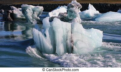 Glacial lake Jokulsarlon in Iceland - Floating icebergs in...