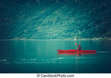 Glacial Lake Kayaking. Caucasian Sportsman Paddling in the...