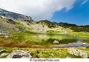 Glacial Lake Vidal in Parang mountains, Romania - Landscape...