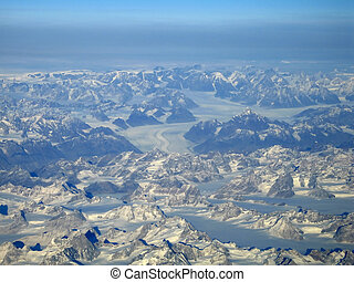 Glacier - Aerial view of glaciers surrounded by peaks in...
