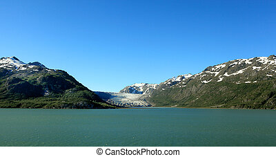glacier bay, alaska, with snow-capped mountains