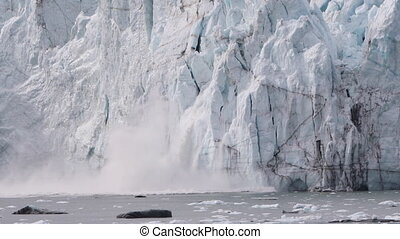 Glacier calving in Alaska. Glacier Bay Alaska cruise vacation travel. Global warming and climate change concept with melting ice falling in water. landscape of Margerie Glacier.