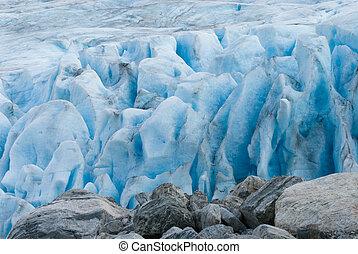 Close up photo of an aquamarine blue gacier crevasse