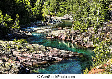 Glacier Fed Stream - Brilliant turquoise water flows through...