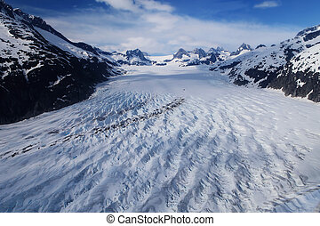 Glacier field - Glacier carving through mountainous ...