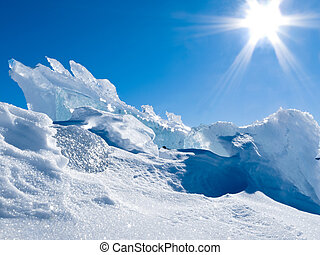 Glacier ice chunks with snow and sunny blue sky - Icy heap...
