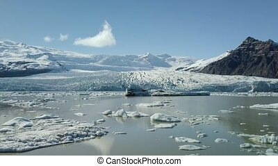 Glacier in Iceland - Glaciesr lake with icebergs at...