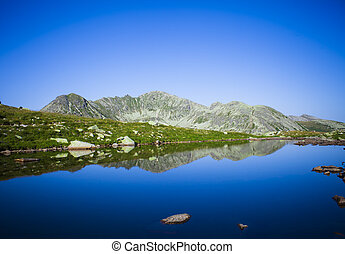glacier lake in Retezat mountain landscape, Romania