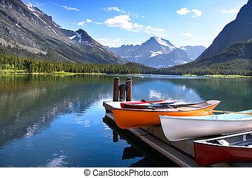 Glacier National park - Canoes by lake Mc Donald in Glacier...
