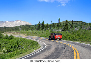 Glacier national park - Red tour bus on road in scenic...