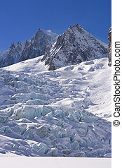 glacier of mont blanc in a blue sky day