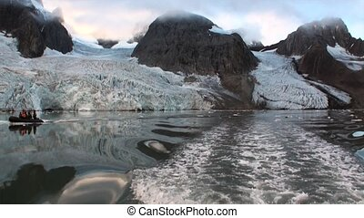 Glacier on the coast in the background of water of Arctic...