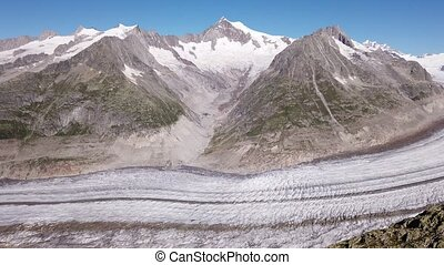 Panorama of largest glacier in the Alps, the Aletsch Arena Glacier, the largest glacier from Eggishorn summit viewpoint in Canton of Valais, Switzerland, Europe. Summer season, clear blue sky.