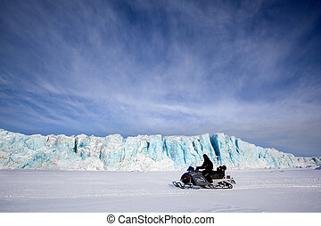 Glacier with Snowmobile - A glacier in Svalbard, Norway with...