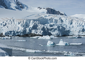 glaciers and mountains on the coast of the Antarctic Peninsula, a sunny summer day