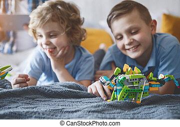 Glad children having fun with plastic toys