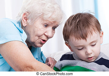 Glad grandma with little boy