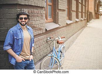 Glad guy having break during cycling