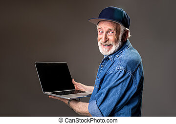 Glad hoary old man with computer - Contented grey haired...
