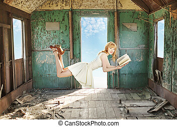 Glad levitating redhead with the book - Glad levitating...
