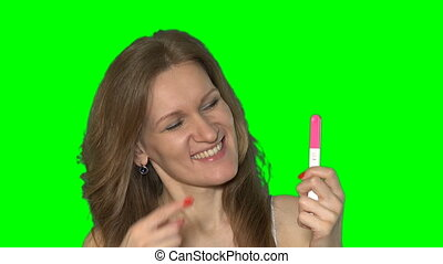 glad mad attractive woman show positive pregnant test with...