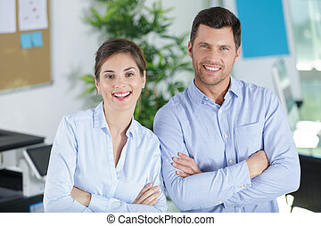 glad man and woman at work place