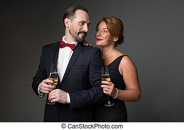 Glad man and woman celebrating their anniversary
