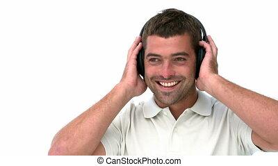 Glad man listening music against a white background