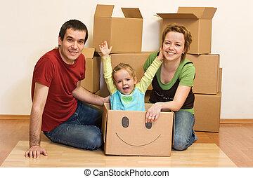 glad släkt, in, deras, nytt hem, sitta på golvbeläggningen