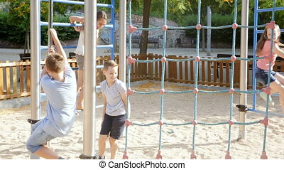 Glad smiling children playing at the playground together