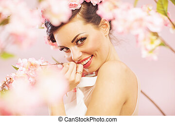 Glad smiling woman with flowers in hair - Glad smiling lady...