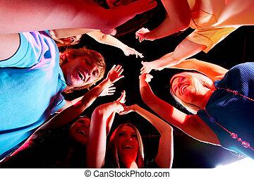 Glad teens - Joyful teens enjoying themselves in night club...