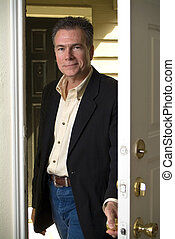 Glad to be Home - A man entering through his front door with...