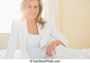 Glad woman looking at camera posing