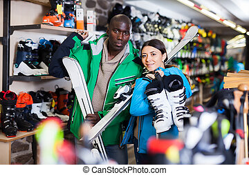 Glad young couple in skiing outfit