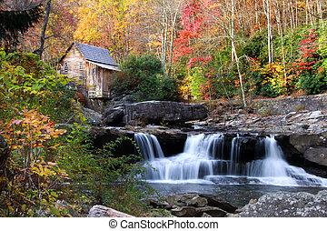 Glade creek grist mill in autumn time with  water falls