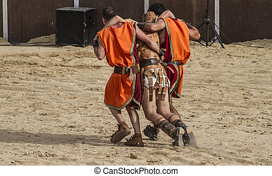 gladiator fights in the arena of the Roman circus,...