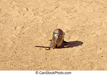 gladiator helmet - a helmet lying on the ground after a...