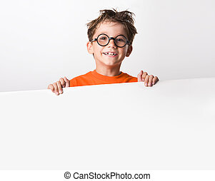 Image of joyful guy in glasses holding white partition and looking at camera with smile