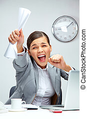 Image of young businesswoman shouting in luck