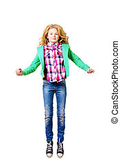 Portrait of a cheerful ten years girl jumping for joy. Isolated over white.